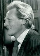 Michael Heseltine smiling.
