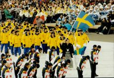 The Swedish Olympic squad enters the fan carrier during the opening of the Winter Olympics in 1998