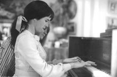 Geraldine Leigh Chaplin playing piano.