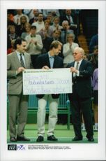 "Tennis player Stefan Edberg thanks Peter Wallenberg for SEK 800,000 to ""Stefan Edberg's foundation"" during the Stockholm Open 1996"