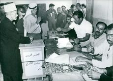 An elderly Arab casts his vote in local elections in Israel.
