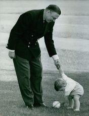 John Ambler playing with his child.