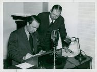 Radio Service Record for Defense Preparedness. Dr. Wilson reads out the incoming telegram. T.H. says Dymling