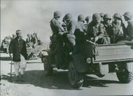1943 Allied Troops roll toward Tunisia A motor convoy of United States and British soldiers passes a civilian somewhere in Algeria as Allied troops move toward the battlefronts of Tunisia.