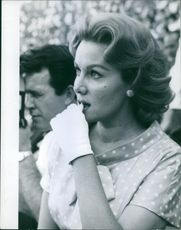 Photograph of Rhonda Fleming. She was an American film and television actress.  A man, standing behind her.