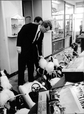 Robert F. Kennedy checking toys.
