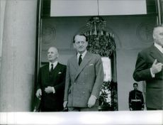 André Malraux is standing with some of his officials in his office building