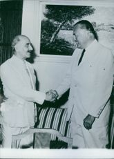 General Grivas  shaking hand with Galo Plaza.