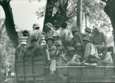 Vietnamese soldiers in transport on a truck fleet in central Kampuchea