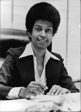Eleanor Holmes Norton at her desk, in her office.