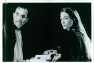 Theresa Russell and Alex Rocco in the film The Spy Within, 1995.