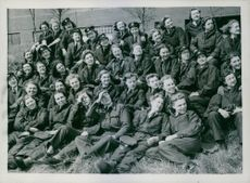 Female soldiers sitting together and facing camera. 1942.