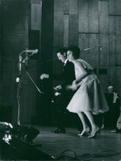 A man and a woman dancing on stage.