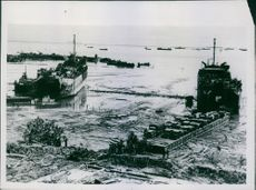 1945  American landing ships lie beached at low tide at Tarakan Island., on the day of the initial landing .
