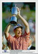 Golf player Ernie Els holds up bucklan after the win in the US Open 1997