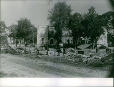 View of a damaged building in an empty street.