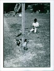 A man on the ground tying the surrounding rope.