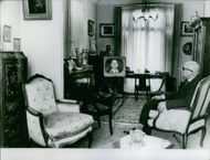 Maurice Challe is sitting inside the living room. 1962