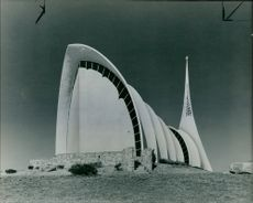 A Portrait of a white Igloo shape Church Structure.