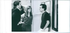 """A photo of Huge Grant, Julianne Moore and Chris Columbus in a film """"Nine Month""""-1995"""