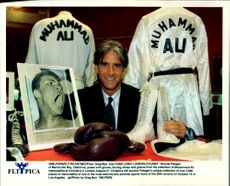 Ronnie Paloger with some of the 3000 items included in his Muhammad Ali collection. The items are sold at Christie's auction.