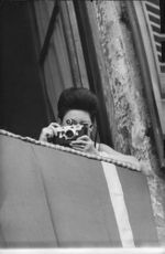 Princess Margaret clicking photograph.