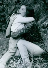 Marisa Pavan embracing her son.