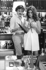 David Hemmings shopping with his wife.