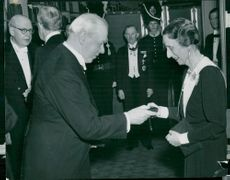 Swedish Academy's Annual High Day. Queen Louise receives this year's memory of Anders Österling