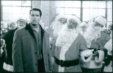 """A photo of Arnold Schwarzenegger as Howard Langston and James Belushi in the film """"Jingle All the Way"""". 1996."""