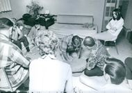 People sitting together in a room.