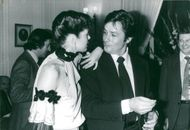 """Actors Sylvia Kristel and Alain Delon celebrate the end of the filming of the movie """"Airport '79"""" at Plaza Athenee"""