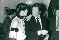 "Actors Sylvia Kristel and Alain Delon celebrate the end of the filming of the movie ""Airport '79"" at Plaza Athenee"