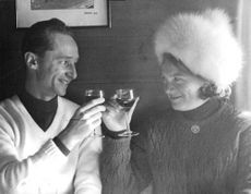 Princess Irene of Netherlands tossing a glass half full of wine with her husband Duke Carlos Hugo. 1964.