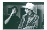 Director Steve Kloves standing with Dennis Quaid as Arlis Sweeney preparing to shoot a scene from the film