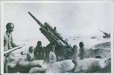 Soldiers using cannons during wartime.