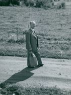 Gunnar Hedlund, the center party leader, walks on a country road