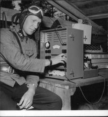 A Finnish soldier being photographed while operating a machine during Continuation War in 1941