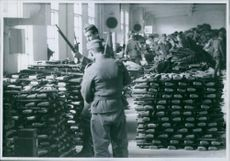 Soldiers looking their weapon during the Yugoslav war, 1941.