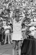 Chris Evert holds up the cup after the win in the final against Hana Mandlikova in the US Open 1982