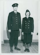 Man and woman in post uniform