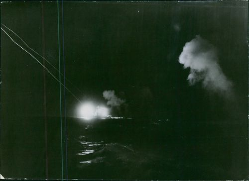 Splash of white light during the night raid of U.S. Navy at the Japanese airfield in Bougainville in the South Pacific.