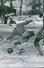 Footballers playing football, falling down. 1944