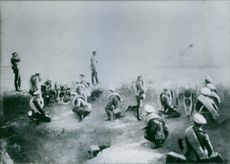 Soldiers gathered and taking position.