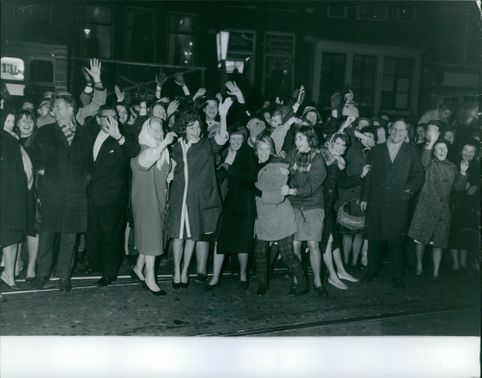 The crowd cheering cheerfully. March 4, 1962