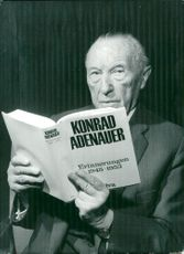 Konrad Adenauer with his recently published memoirs