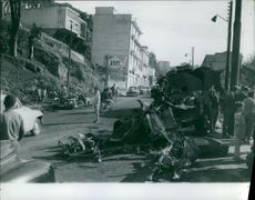 Damage part of vehicles, people looking at something. 1962