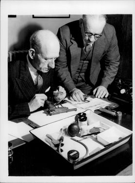 The Forensic Department at Scotland Yard investigates evidence.