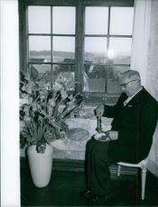 A guest eating his meal by the window at Diane and Carl, Duchess and Duke of Württemberg, wedding reception.