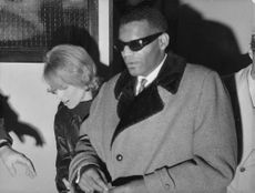 Ray Charles Robinson with woman.